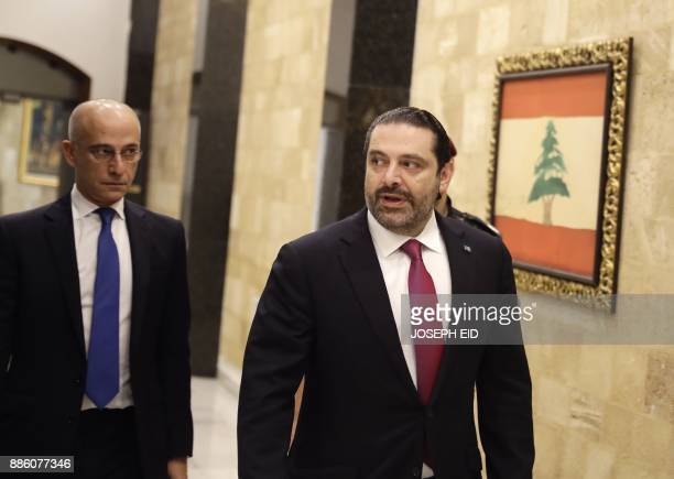 Lebanese Prime Minister Saad Hariri arrives to attend a cabinet meeting at the presidential palace of Baabda east of the capital Beirut on December 5...