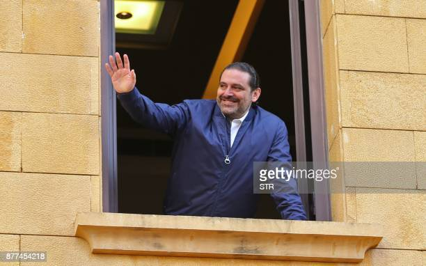 TOPSHOT Lebanese prime minister Saad Hariri greets his supporters upon his arrival at his home in Beirut on November 22 2017 Hariri back in Beirut...
