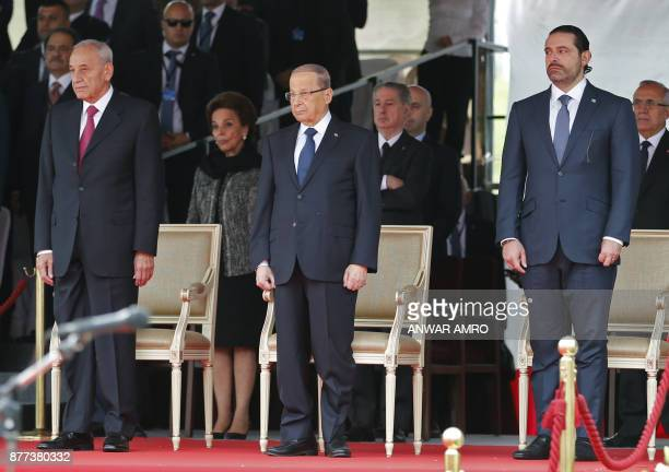 TOPSHOT Lebanese prime minister Saad Hariri President Michel Aoun and House Speaker Nabih Berri attend a military parade to celebrate the 74th...