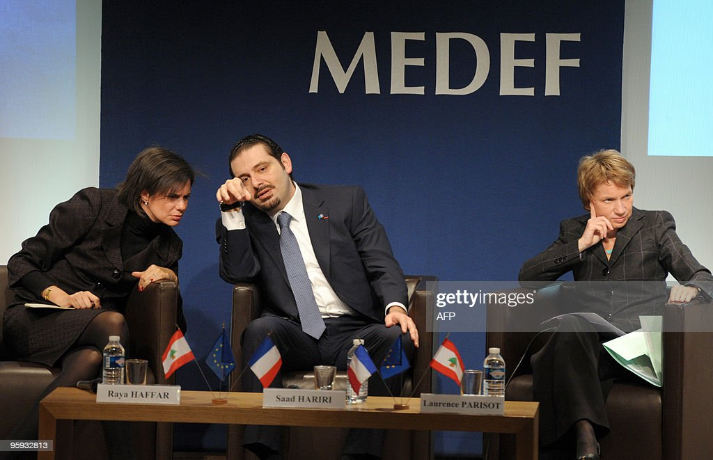 Lebanese Prime Minister Saad Hariri talks with Lebanese Finance Minister Raya Haffar at the French employers' Medef association on January 22 2010 at...