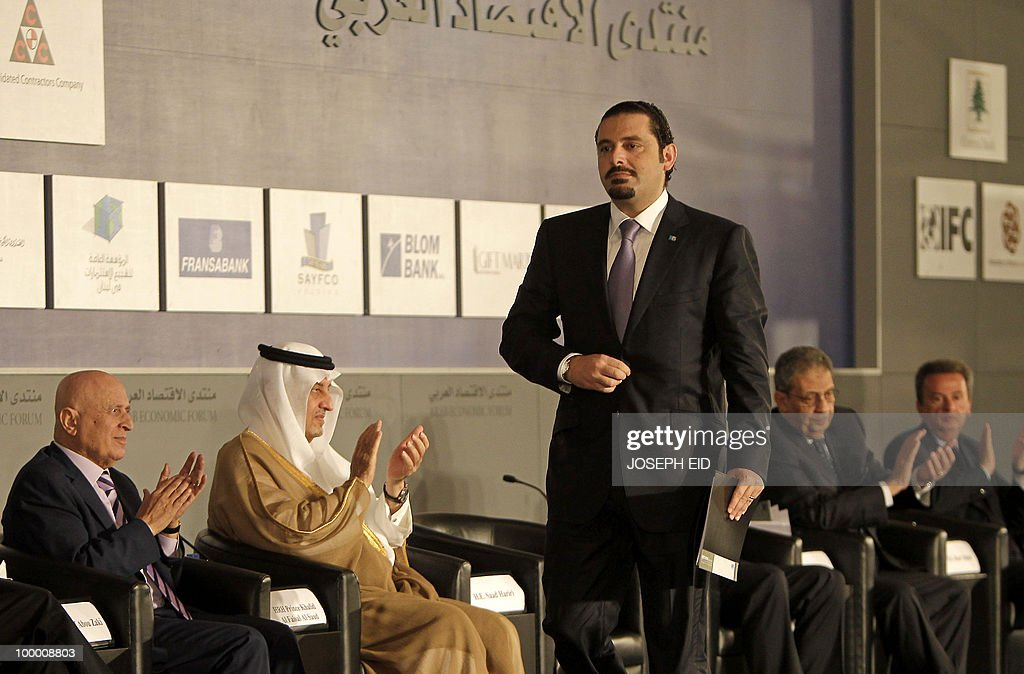 Lebanese Prime Minister Saad Hariri walks towards the podium to address the opening session of the Arab Economic Forum in the Lebanese capital Beirut on May 20, 2010.
