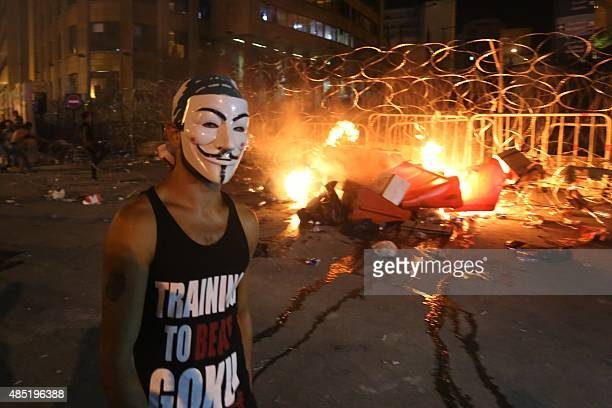 A Lebanese protester wearing a Guy Fawkes mask clashes with security forces following a demonstration against the ongoing trash crisis on August 25...