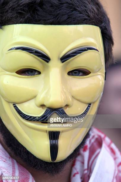 A Lebanese protester wears a Guy Fawkes mask used by the anonymous movement during a mass rally against a political class seen as corrupt and...