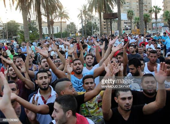 Lebanese protesters chant slogans during a demonstration in support of the 'You Stink' campaign to protest against the ongoing country's trash crisis...