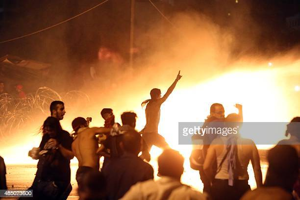 Lebanese protesters clash with riot police following a demonstration organized by 'You Stink' campaign to protest against the ongoing country's trash...