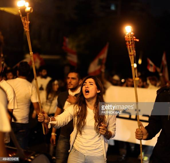 Lebanese protesters hold torches during a demonstration organized by 'You Stink' campaign to protest against the country's ongoing trash crisis on...