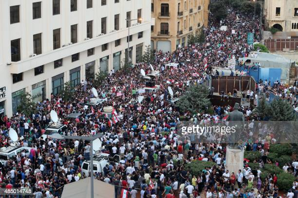 Lebanese protesters wave the national flag during a demonstration organized by 'You Stink' campaign to protest against the ongoing country's trash...