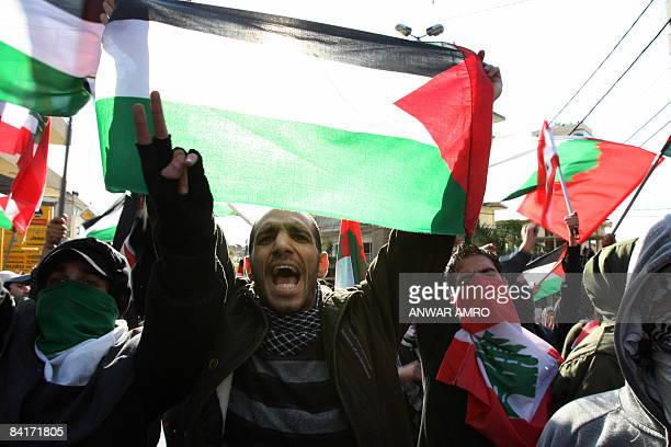 A Lebanese protestor holds a Palestinian national flag during a demonstration against Israel's attacks on the Gaza Strip next to US embassy in Awkar...