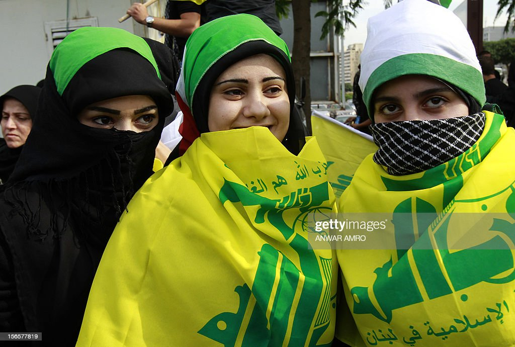 Lebanese protestors wearing the Hezbollah flag gather during a protest against the ongoing attack on Gaza outside the offices of the United Nations Economic and Social Commission for Western Asia (ESCWA) in Lebanese capital Beirut, on November 17, 2012. Lebanese political factions alongside their Palestinian counterparts gathered in the Lebanese capital, as the ongoing assault on Gaza strip took the death toll from three days of Israeli raids to 40, medics said.