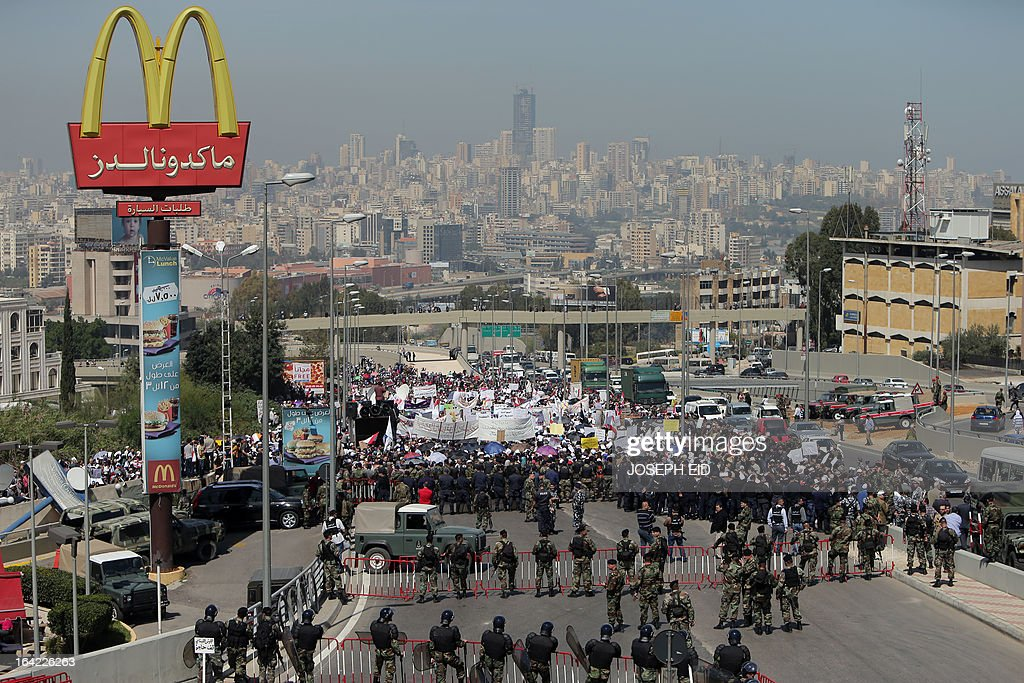 Lebanese public sector employees protest near the presidential palace in Baabda east of the Lebanese capital Beirut on March 21, 2013 to demand an increase in wages. AFP PHOTO/JOSEPH EID