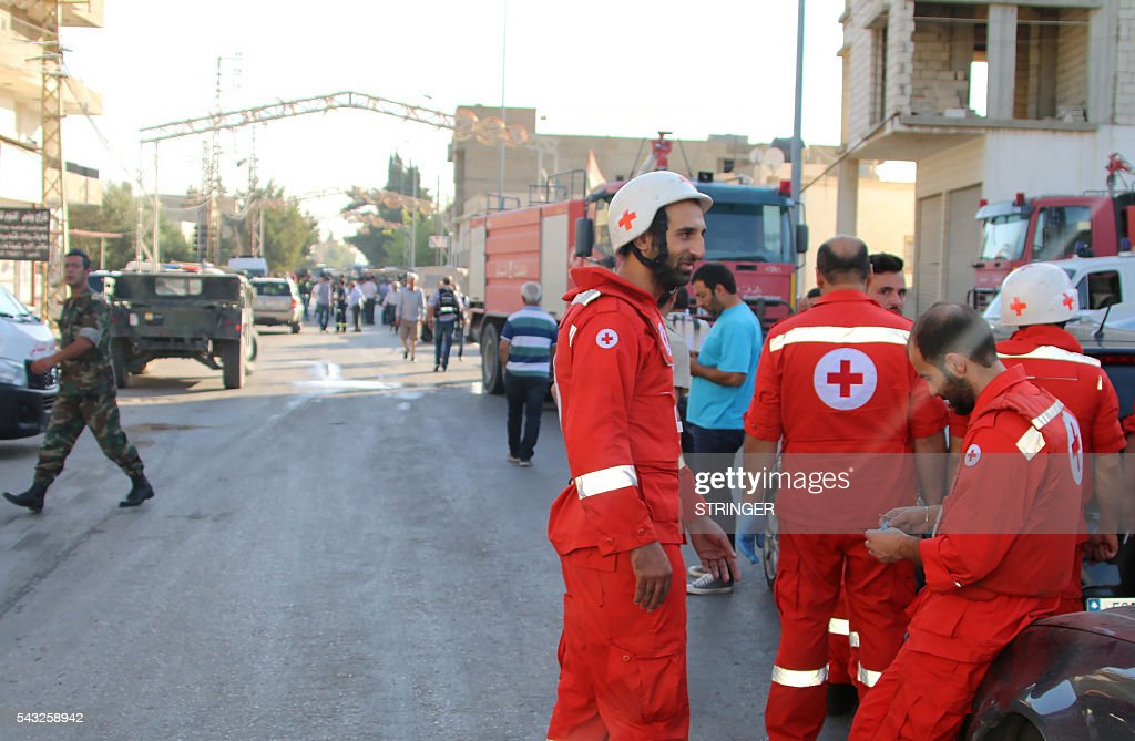 Lebanese Red Cross members are seen at the site of multiple suicide bombings which took place early on June 27, 2016 in the predominantly Christian village of Al-Qaa, in eastern Lebanon near the border with Syria. Al-Qaa is one of several border posts separating Lebanon and war-torn Syria. The border area has been rocked by clashes and shelling since Syria's conflict erupted in 2011. / AFP / STRINGER