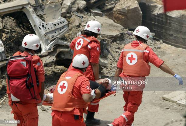 Lebanese Red Cross staff carry a man acting as a wounded victim on a stretcher as they participate in a drill organized by the Lebanese Army and...