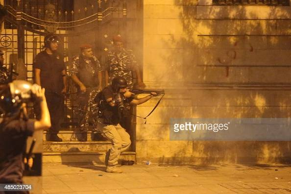 Lebanese riot police fire rubber bullets towards protesters during clashes following a demonstration organized by 'You Stink' campaign to protest...