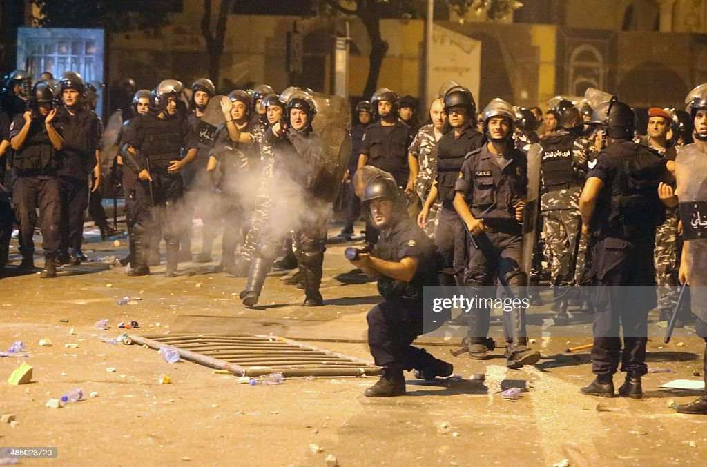 Lebanese riot police fire tear gas towards protesters during clashes following a demonstration organized by 'You Stink' campaign to protest against...