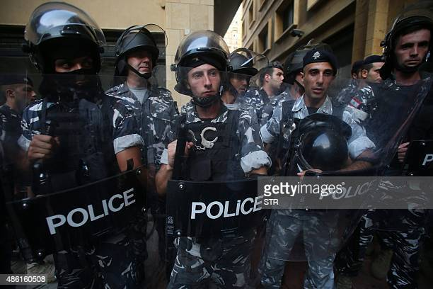 Lebanese riot police prepare to forcefully evict protesters who had occupied part of the environment ministry in a surprise sitin to demand the...