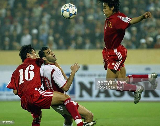 Lebanese Rodar Antar fights for the ball with Vietnamese Tran Hai Lam and Nguyen Huy Hoang during a qualyfying football match between Vietnam and...