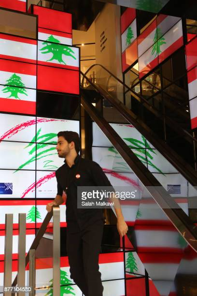 Lebanese salesman passes by the Lebanese flag in the background in a shop in downtown Beirut Lebanon on Tuesday November 21 2017 Lebanon's prime...
