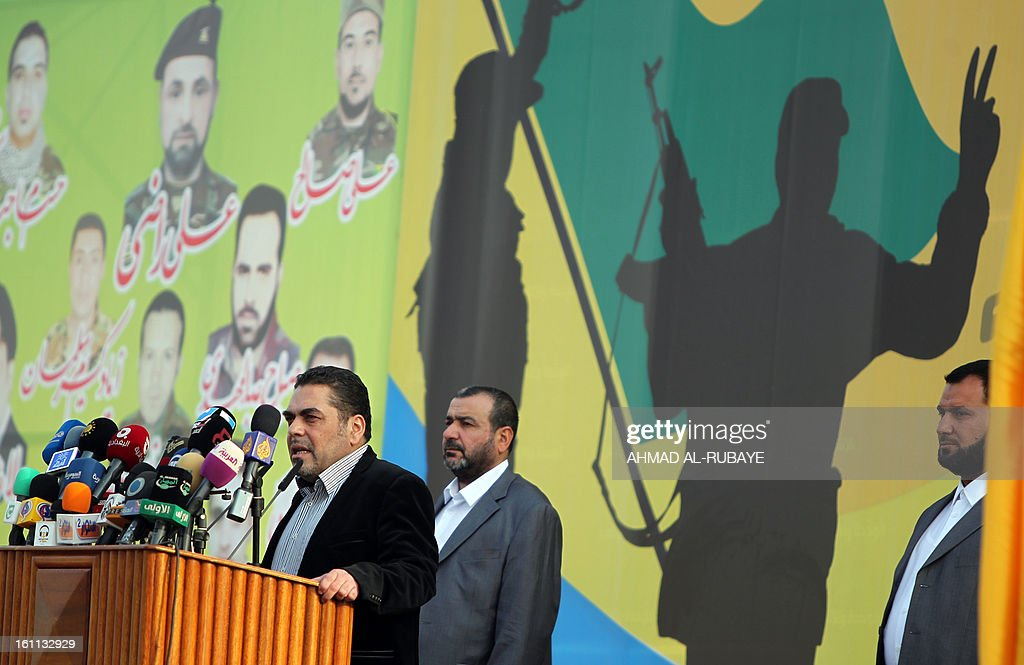 Lebanese Samir Kantar, a prisoner freed by Israel during a prisoner swap in 2008, addresses Iraqi scouts whose organization follows the Lebanese Hezbollah Shiite Muslim political party, during a celebration in the Iraqi capital Baghdad on February 9, 2013, to commemorate the withdrawal of US troops from Iraq in December 2011 ending nearly nine years of the mainly US-led occupation of Iraq.