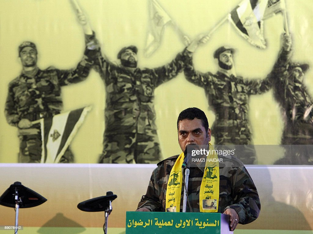 Lebanese Samir Kantar, a prisoner freed by Israel during a prisoner swap, speaks during a celebration marking the first anniversary of the swap between Hezbollah and Israel, in Beirut on July 17, 2009. The July 16, 2008 prisoner swap included the return of 199 bodies, along with the release of the remaining five Lebanese prisoners in Israel. In exchange, Hezbollah handed over the bodies of two Israeli soldiers captured in a cross-border raid on July 12, 2006, sparking a devastating 34-day war. AFP PHOTO/ RAMZI HAIDAR