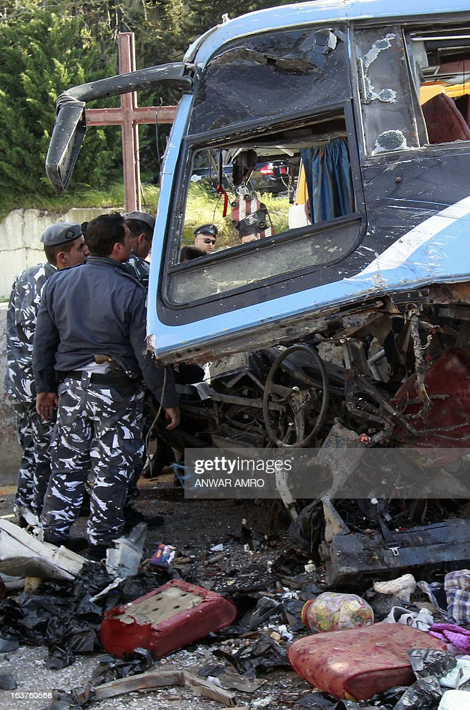 Lebanese security forces inspect the scene of a bus crash, killing and wounding several people, in the town of Kahaleh, ten kilometres east of Beirut on March 15, 2013, that was carrying Syrian refugees upon their arrival from Syria to Lebanon. AFP PHOTO/ ANWAR AMRO