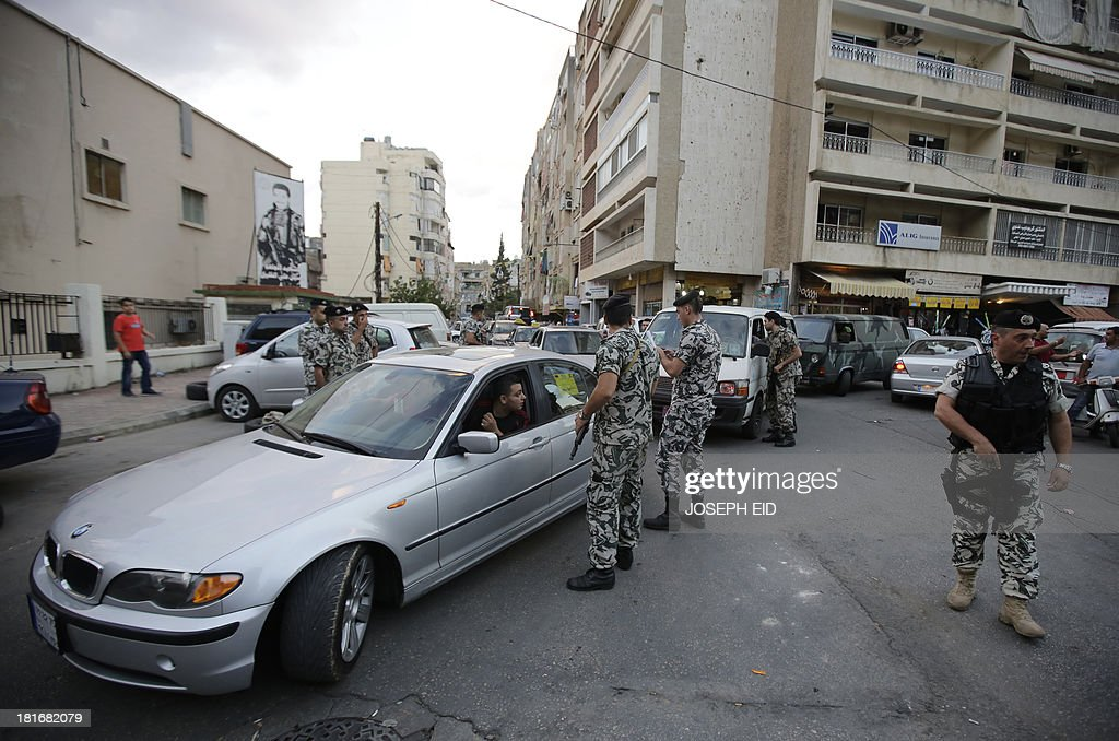 Lebanese security forces man a checkpoint in the southern suburb of the capital Beirut on September 23, 2013. Lebanese troops are to take over security at checkpoints set up by the Hezbollah movement in their southern Beirut stronghold after two bombings, the interior minister told AFP. AFP PHOTO/JOSEPH EID