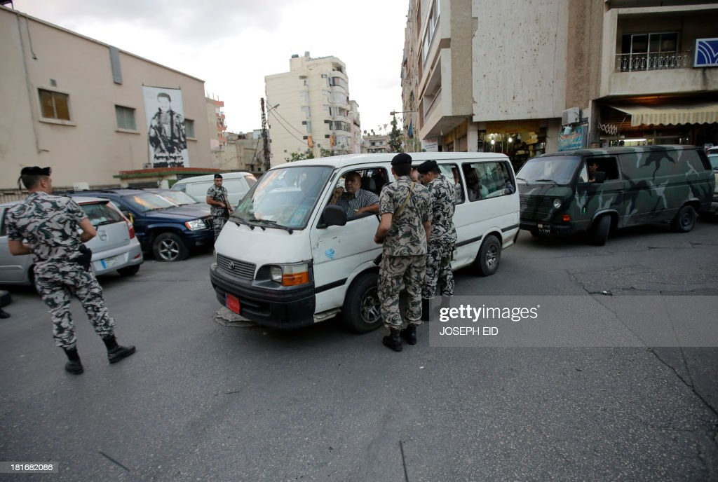 Lebanese security forces man a checkpoint in the southern suburb of the capital Beirut on September 23, 2013. Lebanese troops are to take over security at checkpoints set up by the Hezbollah movement in their southern Beirut stronghold after two bombings, the interior minister told AFP.