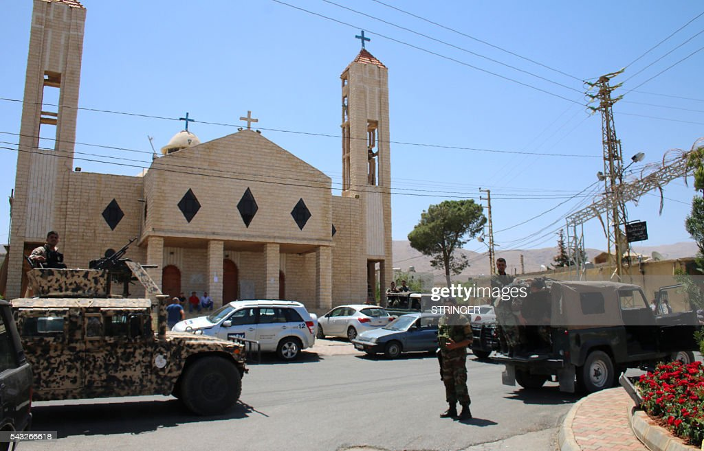 Lebanese security forces secure the site of multiple suicide bombings which took place early on June 27, 2016 in the predominantly Christian village of Al-Qaa, in eastern Lebanon near the border with Syria. Al-Qaa is one of several border posts separating Lebanon and war-torn Syria. The border area has been rocked by clashes and shelling since Syria's conflict erupted in 2011. / AFP / STRINGER