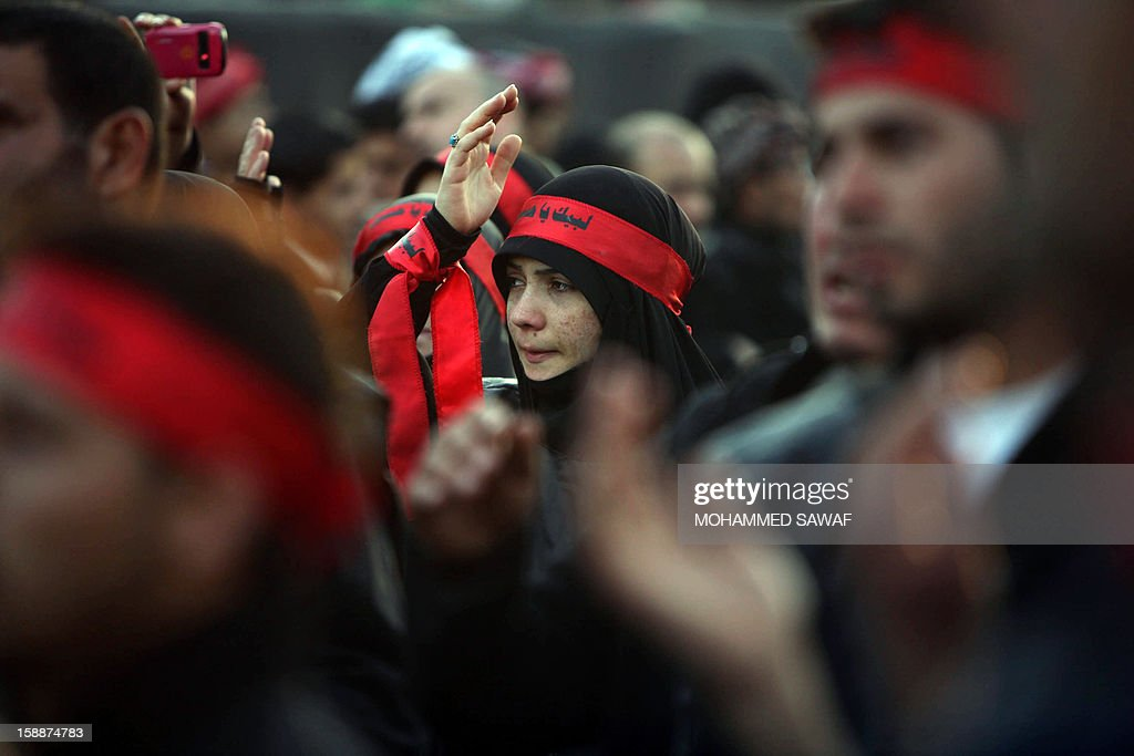 A Lebanese Shiite Muslim pilgrim take part in the Arbaeen religious rituals which marks the 40th day after Ashura commemorating the seventh century killing of Prophet Mohammed's grandson, Imam Hussein, in the shrine city of Karbala, southwest of Iraq's capital Baghdad, on January 2, 2013.