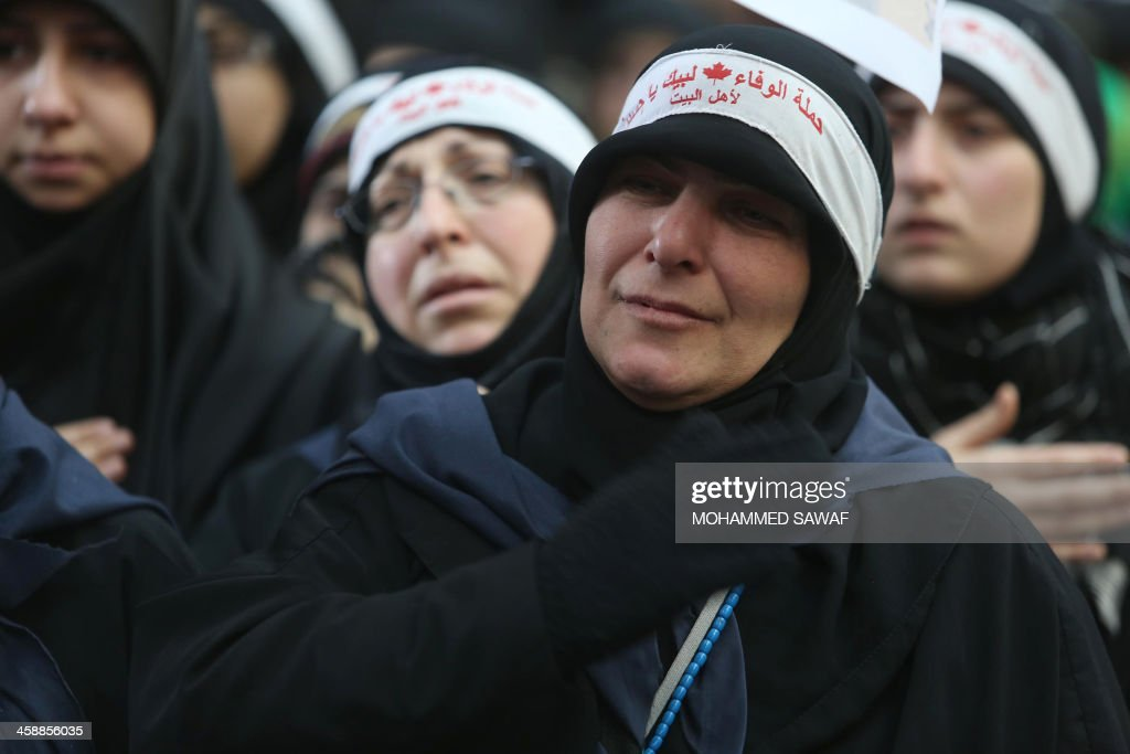 Lebanese Shiite Muslim pilgrim women gather in the Shrine of Imam Abbas in the central Iraqi city of Karbala, on December 22, 2013, as they take part in the Arbaeen religious festival which marks the 40th day after Ashura commemorating the seventh century killing of Prophet Mohammed's grandson, Imam Hussein.