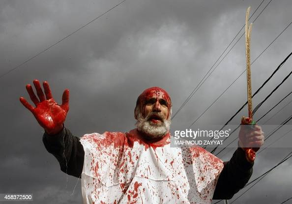 A Lebanese Shiite Muslim takes part in a selfflagellation procession during the Ashura commemorations that mark the killing of Imam Hussein one of...