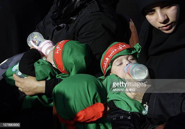 Lebanese Shiite Muslim women and supporters of the Islamic movement Hezbollah feed their babies as they take part in in Beirut's southern suburb on...