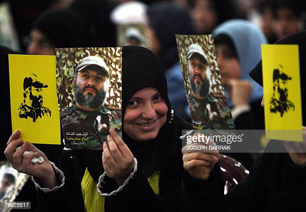 Lebanese Shiite Muslim women holdup images of assassinated top Hezbollah commander Imad Mughnieh as they gather to watch a televised speech by Hassan...