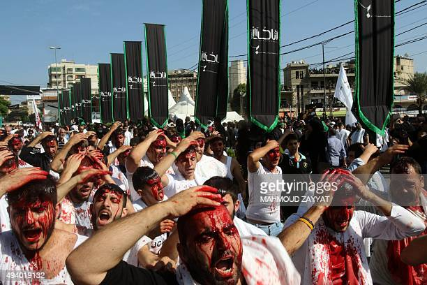 Lebanese Shiite Muslims take part in a selfflagellation procession on the tenth day of the mourning period of Muharram which marks the day of Ashura...