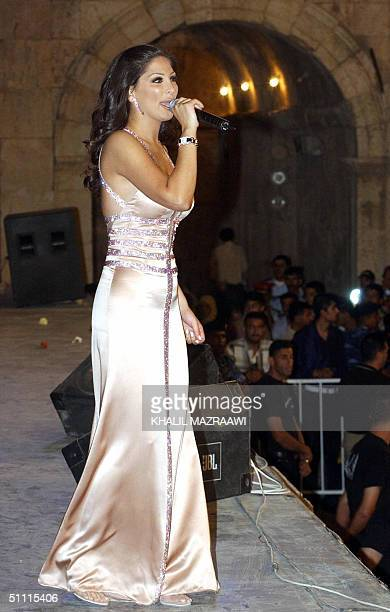 Lebanese singer Elissa performs at the southern theater of Jarash north of Amman late 25 July 2004 The Jarash Festival will continue with its many...
