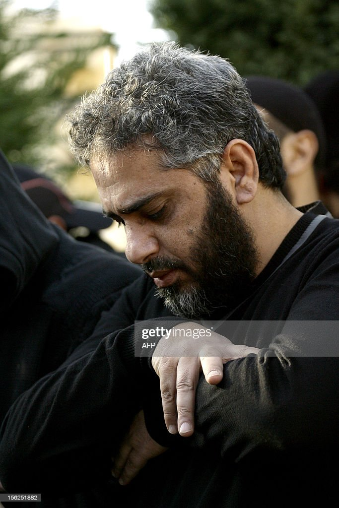 Lebanese Singer Fadel Shaker prays during a funeral in the southern Lebanese port city of Sidon, on November 12, 2012. Three people were killed in Sidon in a gunbattle between supporters of the Shiite group Hezbollah and a hardline Sunni cleric, a security official said. AFP PHOTO / MAHMOUD ZAYYAT