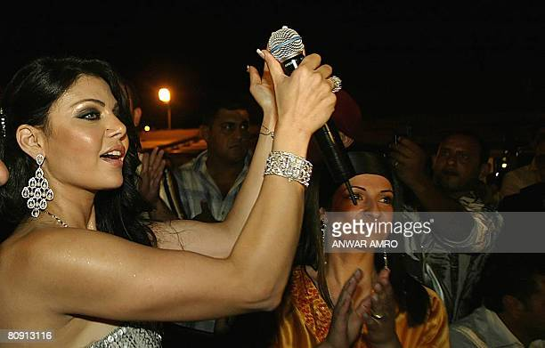 Lebanese singer Haifa Wehbe performs at a beach resort at the southern Lebanese city of Tyre 15 July 2007 Bahrain's Islamistdominated parliament on...