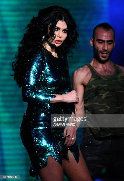 Lebanese singer Haifa Wehbe performs during the Mr Lebanon beauty contest in Adma north of Beirut late on January 22 2012 AFP PHOTO/ANWAR AMRO