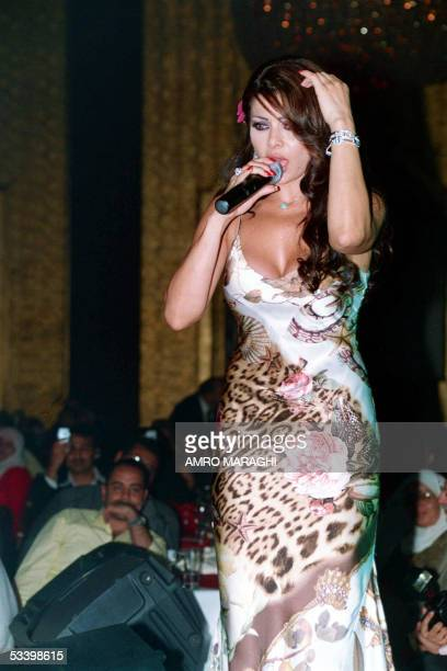 Lebanese singer Haifa Wehbi performs after receiving the best video clip singer award for her song 'Baddi Eish' during the Sixth Video Clip Oscar...