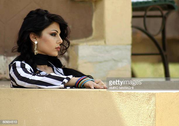 Lebanese singer Haifa Wehbi performs during the shooting of a new video clip directed by Hadi elBaghuri 06 June 2004 in Cairo AFP PHOTO/Amro MARAGHI