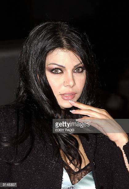 Lebanese singer Haifa Wehbi poses for a picture in Dubai 23 March 2004 AFP Photo/Eddy PADO