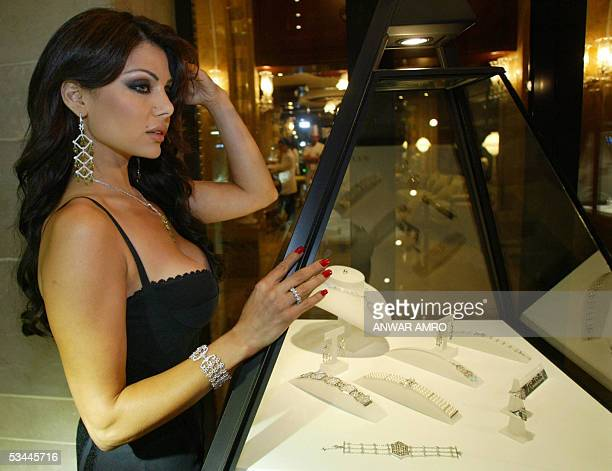 Lebanese singer Haifa Wehbi poses with samples of her newly created jewelry line 20 August 2005 in Beirut AFP PHOTO/ ANWAR AMRO