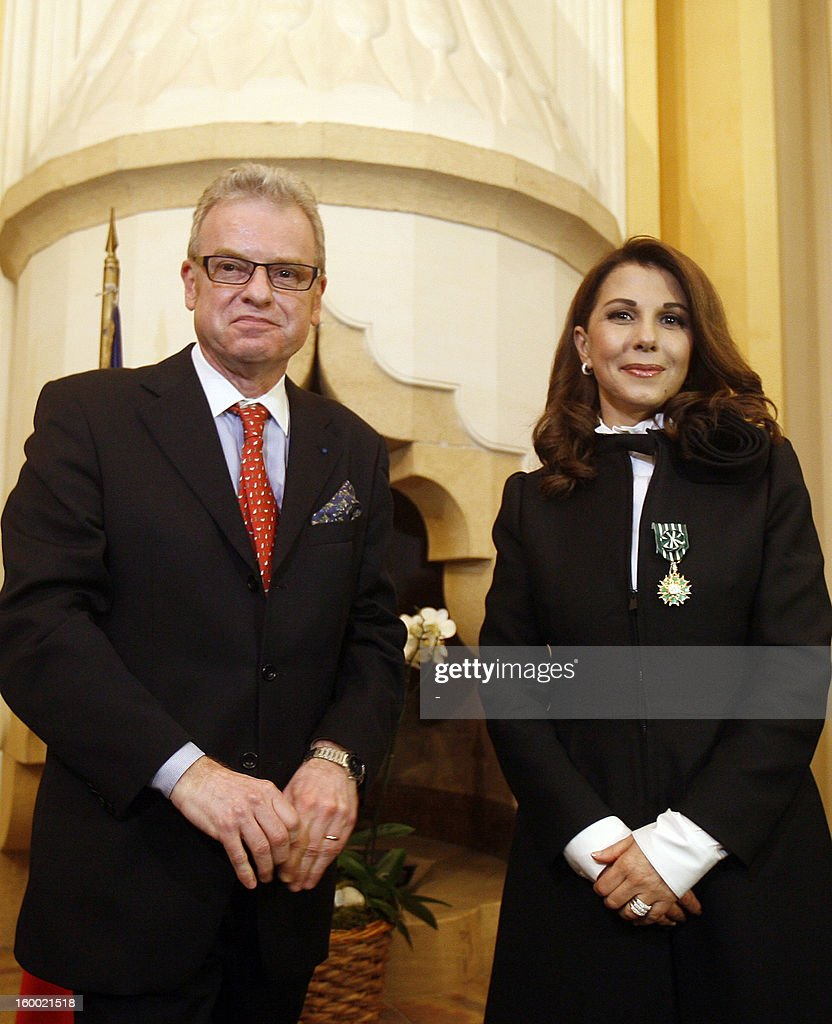 Lebanese singer, Magida al-Roumi poses after being awarded with the Officer of the Order of Arts and Letters medal by French ambassador to Lebanon Patrice Paoli (L) on January 24, 2012 in Beyrouth. STR