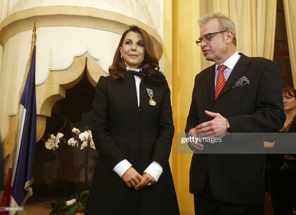 Lebanese singer, Magida al-Roumi poses after being awarded with the Officer of the Order of Arts and Letters medal by French ambassador to Lebanon Patrice Paoli (R) on January 24, 2012 in Beyrouth. STR