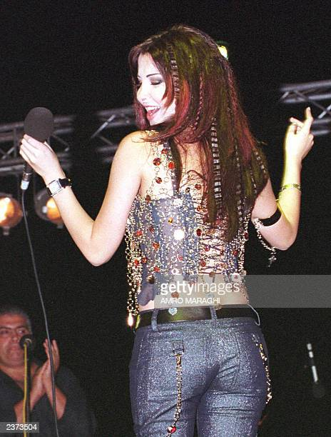 Lebanese singer Nancy Agram performs during the Fourth Videoclip Festival in the Egyptian resort of Sharm ElSheikh late 27 July 2003 AFP PHOTO/Amro...