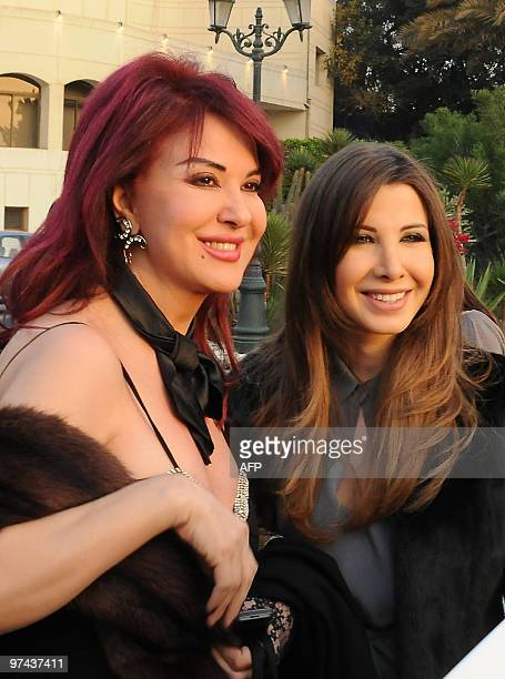 Lebanese singer Nancy Ajram and actress Madeleine Tabr arrive to the opening ceremony of the 20th Cairo International Film Festival for Children in...