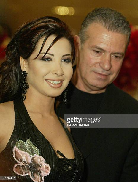 Lebanese singer Nancy Ajram arrives with her business manager Gigi Lamara at the 2003 Murrex D'Or award at Casino du Liban in Jounieh north of Beirut...