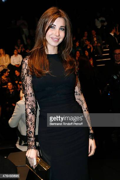 Lebanese singer Nancy Ajram attends the Elie Saab show as part of the Paris Fashion Week Womenswear Fall/Winter 20142015 on March 3 2014 in Paris...