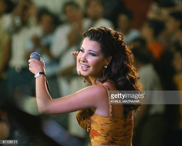Lebanese singer Nancy Ajram performs at Jerash Festival of Culture and Arts late 28 July 2004 at the South Theater of the ancient GreekRoman city of...