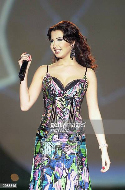 Lebanese singer Nancy Ajram performs at the closing ceremony of Dubai Shopping Festival in Dubai late 15 February 2004 AFP PHOTO/EDDY PADO