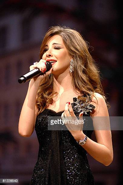 Lebanese singer Nancy Ajram performs at the Mina alSalam hotel in Dubai late on May 23 2008 AFP PHOTO/STR